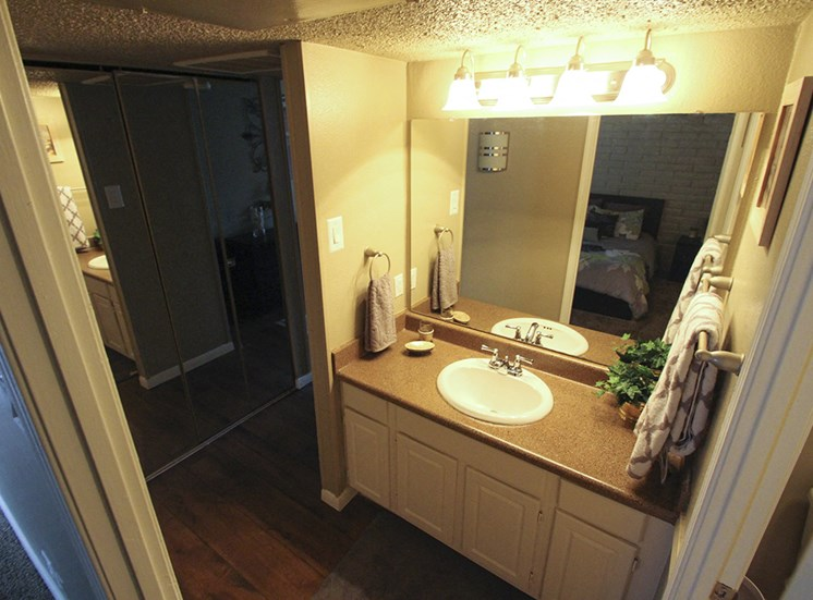 This is a photo of the sink/vanity in the 653 square foot 1 bedroom apartment at Harvard Square Apartments, in Dallas, TX.