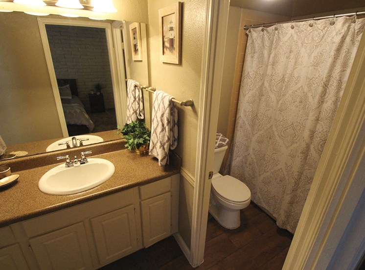 This is a photo of the bathroom in the 653 square foot 1 bedroom apartment at Harvard Square Apartments, in Dallas, TX.