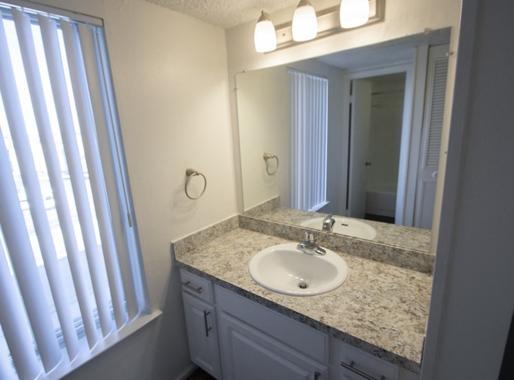 This is a photo of the bathroom vanity in the 500 square foot 1 bedroom apartment at Harvard Square Apartments, in Dallas, TX.