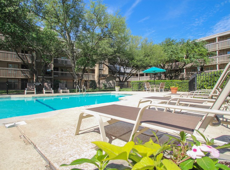 This is a photo of the pool area at Harvard Square Apartments in Dallas, TX.