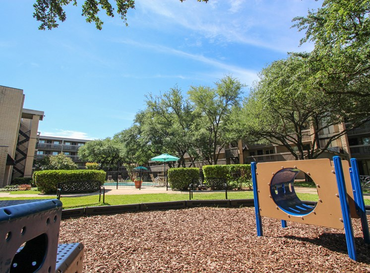 This is a photo of the playground at Harvard Square Apartments in Dallas, TX.