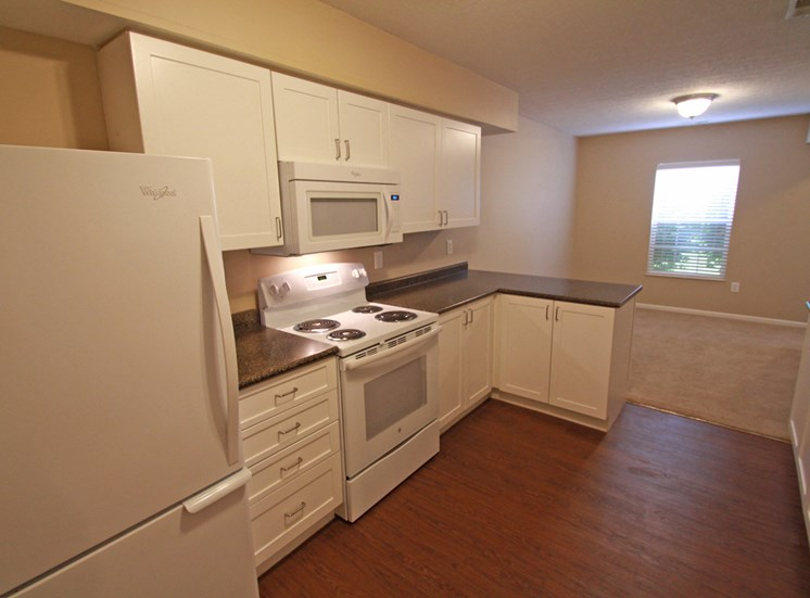 This is a photo of the kitchen in the 1490 square foot 3 bedroom Presidential at Washington Place Apartments in Washington Township, OH.