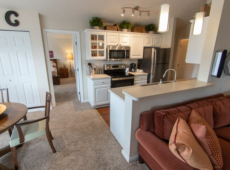 This is a photo looking into the kitchen from the living room in the 1016 square foot, 2 bedroom Nautica floor plan at Nantucket Apartments in Loveland, OH.