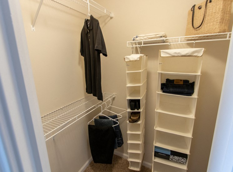This is a photo of the master bedroom walk-in closet in the 1016 square foot, 2 bedroom Nautica floor plan at Nantucket Apartments in Loveland, OH.