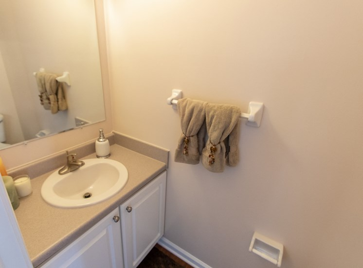 This is a photo of the half bath in the 1242 square foot, 2 bedroom Spinnaker floor plan at Nantucket Apartments in Loveland, OH.