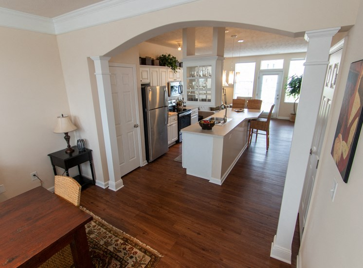 This is a photo looking inbto the kitchen from the dining room in the 1242 square foot, 2 bedroom Spinnaker floor plan at Nantucket Apartments in Loveland, OH.