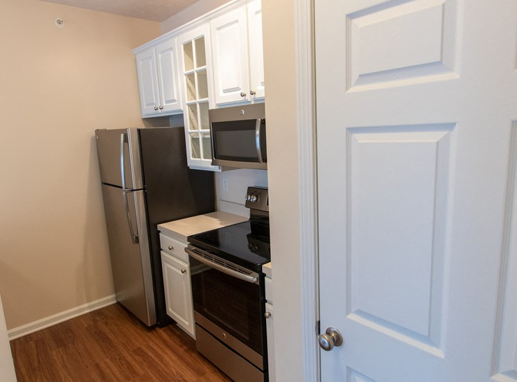 This is a photo of the kitchen and closet with stackable washer dryer connections in the 563 square foot, 1 bedroom Catamaran floor plan at Nantucket Apartments in Loveland, OH.