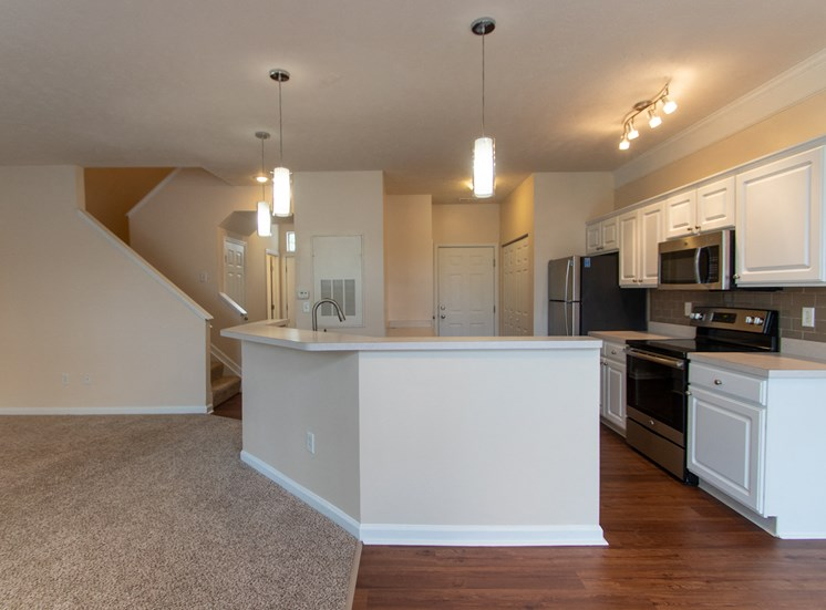This is a photo of the open concept, living room. dining room and kitchen in the 1578 square foot, 3 bedroom Flagship floor plan at Nantucket Apartments in Loveland, OH.