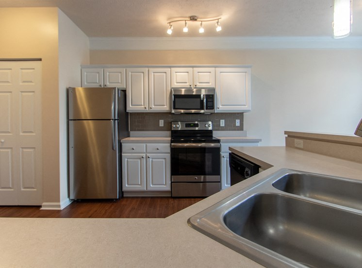This is a photo of the kitchen in the 1578 square foot, 3 bedroom Flagship floor plan at Nantucket Apartments in Loveland, OH.