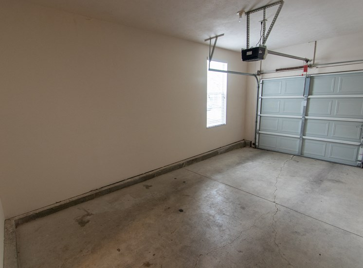 This is a photo of the single car garage in the 1578 square foot, 3 bedroom Flagship floor plan at Nantucket Apartments in Loveland, OH.