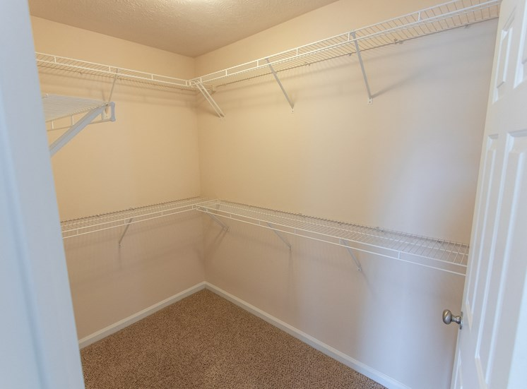 This is a photo of the master bedroom walk-in closet in the 1578 square foot, 3 bedroom Flagship floor plan at Nantucket Apartments in Loveland, OH.