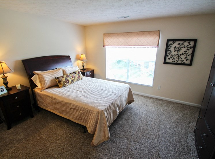 This is a photo of the master bedroom in the 2 bedroom Atlantic floor plan at Nantucket Apartments in Loveland, OH.