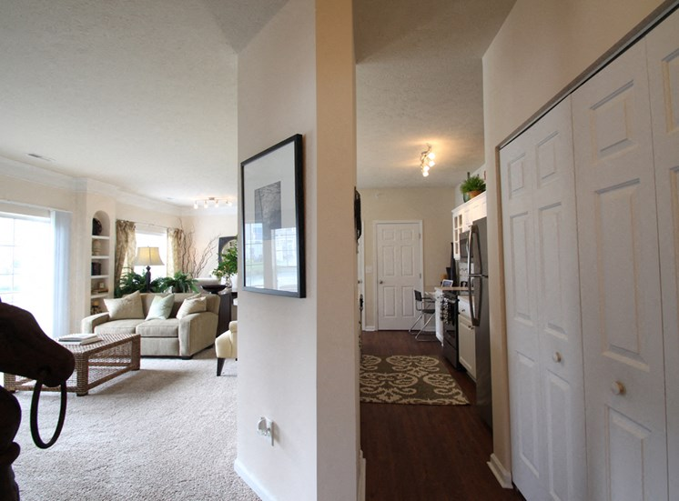 This is a photo of the living room/kitchen in the 2 bedroom Islander floor plan at Nantucket Apartments in Loveland, OH.