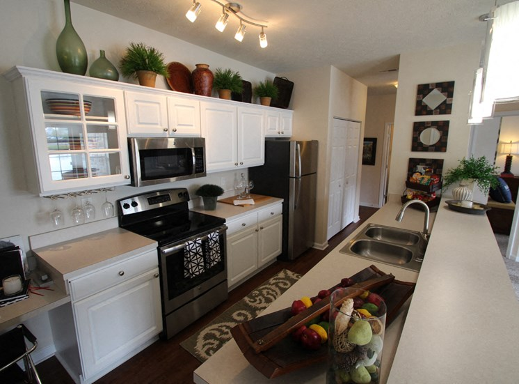 This is a photo of the kitchen in the 2 bedroom Islander floor plan at Nantucket Apartments in Loveland, OH.
