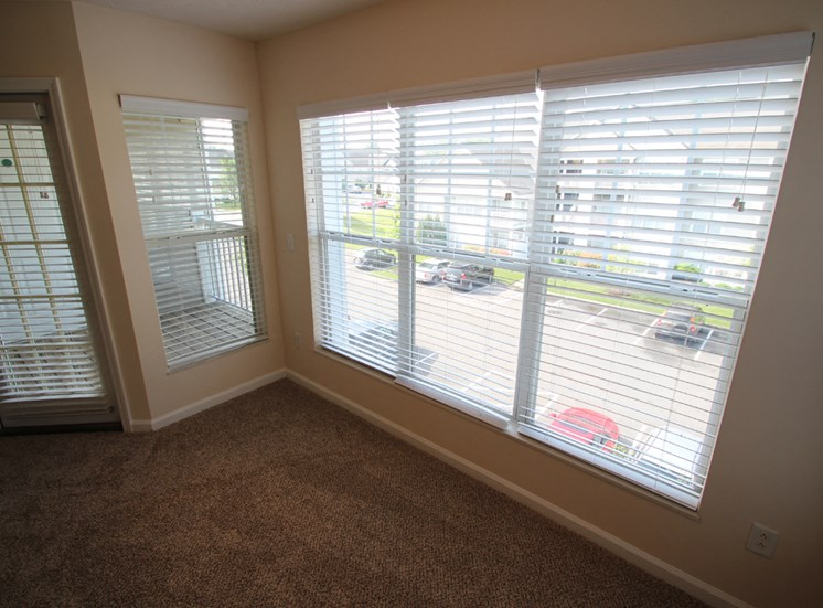 This is a photo of the living room in the 1 bedroom Patriot floor plan at Nantucket Apartments in Loveland, OH.