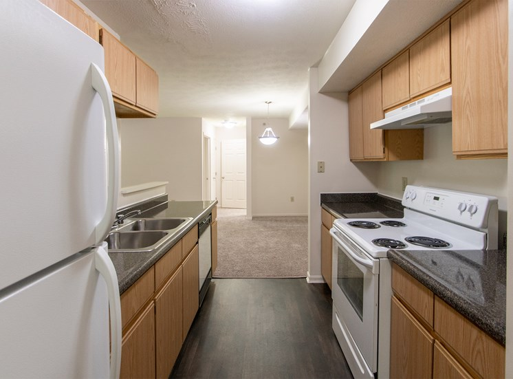 This is photo of the kitchen in the 1056 square foot, 2 bedroom Gainsway floor plan at Trails of Saddlebrook Apartments in Florence, KY.