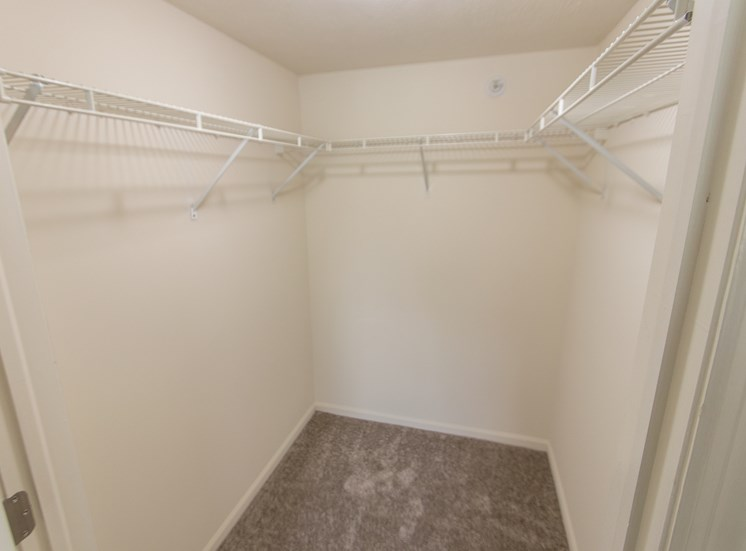 This is photo of the second bedroom walk-in closet in the 1056 square foot, 2 bedroom Gainsway floor plan at Trails of Saddlebrook Apartments in Florence, KY.
