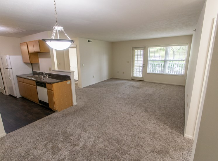 This is photo of the kitchen and living room from the dining in the 1056 square foot, 2 bedroom Gainsway floor plan at Trails of Saddlebrook Apartments in Florence, KY.