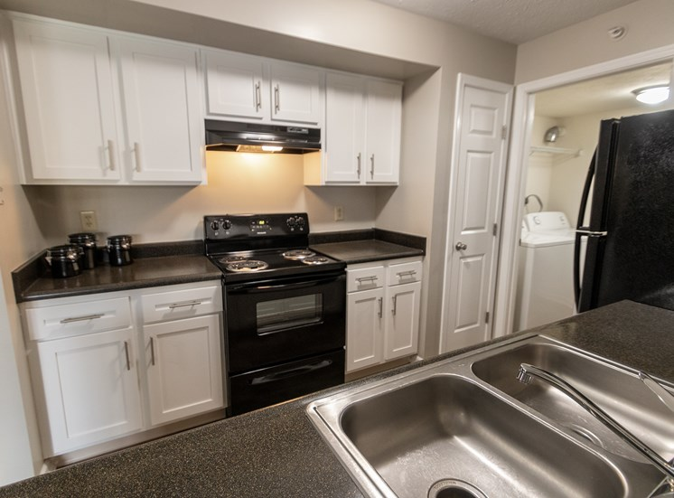 This is a photo of the kitchen in the 1226 square foot 3 bedroom Hambletonian at Trails of Saddlebrook Apartments in Florence, KY.