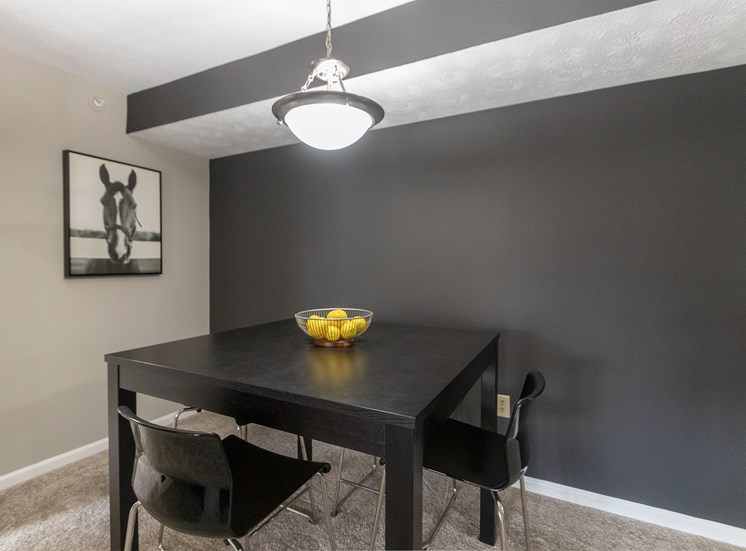 This is a photo of the dining room in the 1226 square foot 3 bedroom Hambletonian at Trails of Saddlebrook Apartments in Florence, KY.