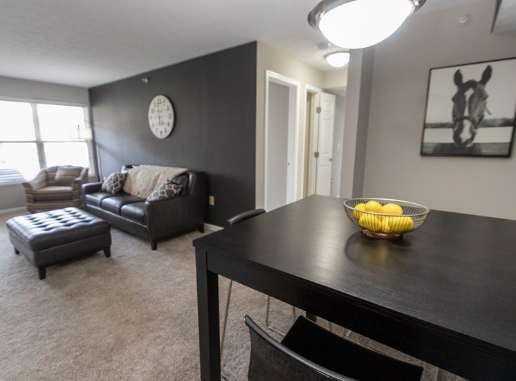 This is a photo of the dining and living rooms in the 1226 square foot 3 bedroom Hambletonian at Trails of Saddlebrook Apartments in Florence, KY.