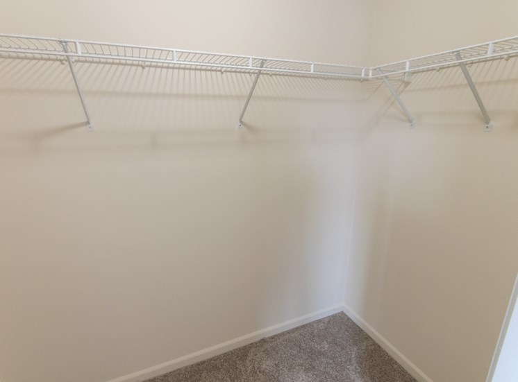 This is a photo of the master bedroom walk-in closet in the 1226 square foot 3 bedroom Hambletonian at Trails of Saddlebrook Apartments in Florence, KY.
