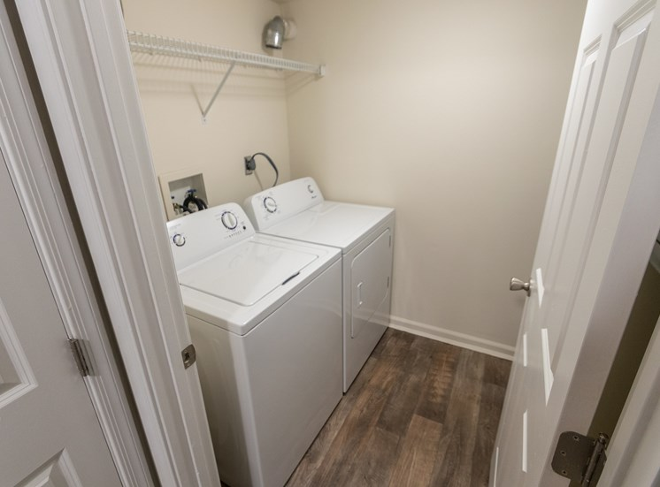 This is a photo of the utility closet (with washer and dryer connections) in the 1226 square foot 3 bedroom Hambletonian at Trails of Saddlebrook Apartments in Florence, KY.