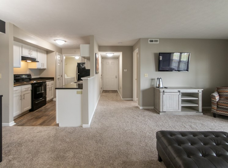 This is a photo of the living room/dining room/kitchen in the 1226 square foot 3 bedroom Hambletonian at Trails of Saddlebrook Apartments in Florence, KY.
