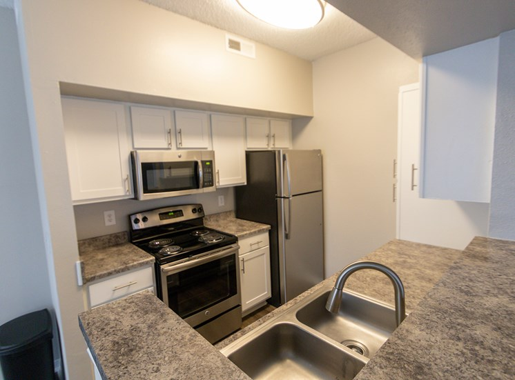 This is a photo of the kitchen in the 900 square foot 1 bedroom Haven floor plan at The Sanctuary at Fishers Apartments in Fishers, IN.