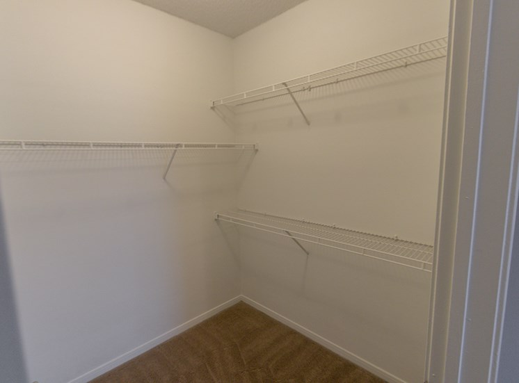 This is a photo of the bedroom walk-in closet in the 900 square foot 1 bedroom Haven floor plan at The Sanctuary at Fishers Apartments in Fishers, IN.