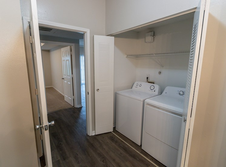 This is a photo of the full-size wahser and dryer closet in the 900 square foot 1 bedroom Haven floor plan at The Sanctuary at Fishers Apartments in Fishers, IN.