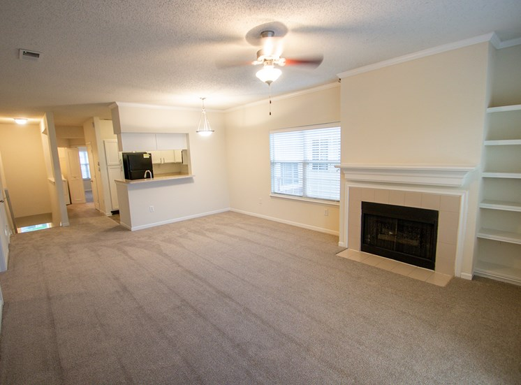 This is a photo of the living room and dining area in the 1025 square foot 2 bedroom Tranquility floor plan at The Sanctuary at Fishers Apartments in Fishers, IN.
