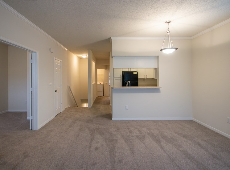 This is a photo of the dining area from the living room in the 1025 square foot 2 bedroom Tranquility floor plan at The Sanctuary at Fishers Apartments in Fishers, IN.
