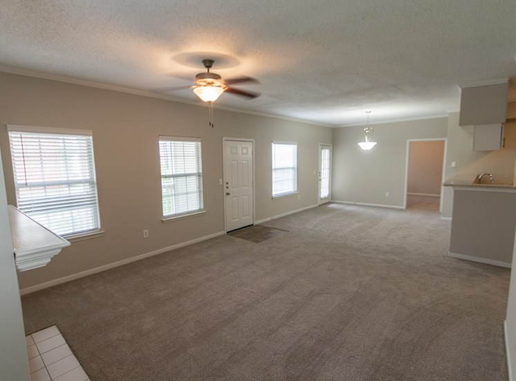 This is a photo of the living room and dining room in the 1515 square foot 3 bedroom Zen floor plan at The Sanctuary at Fishers Apartments in Fishers, IN.