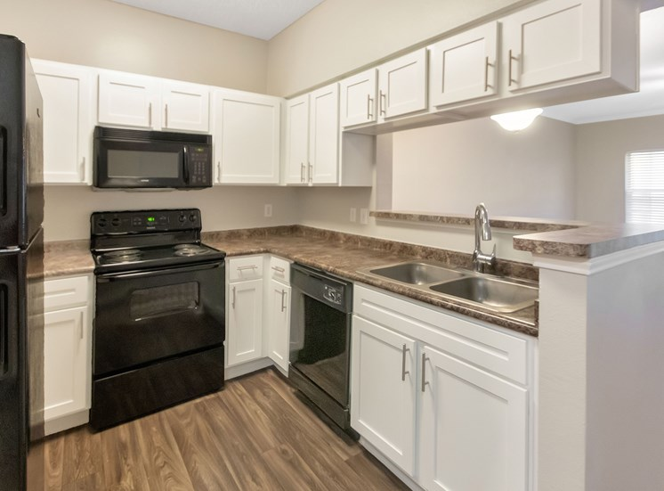 This is a photo of the kitchen in the 1110 square foot, lower 2 bedroom Serenity floor plan at The Sanctuary at Fishers Apartments in Fishers, IN.