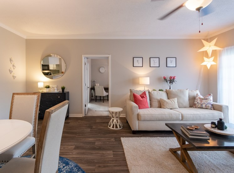 This is a photo of the living room and dining area in the 1135 square foot 2 bedroom Retreat floor plan at The Sanctuary at Fishers Apartments in Fishers, IN.