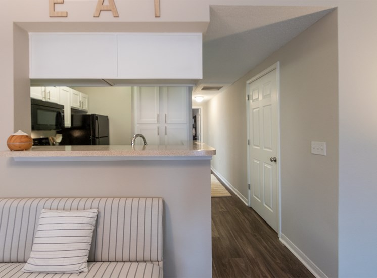 This is a photo looking towards the kitchen from the dining area in the 1135 square foot 2 bedroom Retreat floor plan at The Sanctuary at Fishers Apartments in Fishers, IN.