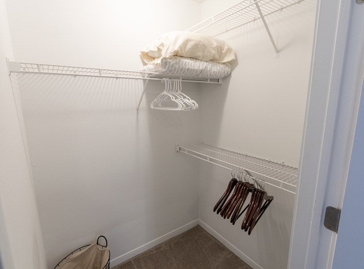 This is a photo of the second bedroom closet in the 1135 square foot 2 bedroom Retreat floor plan at The Sanctuary at Fishers Apartments in Fishers, IN.