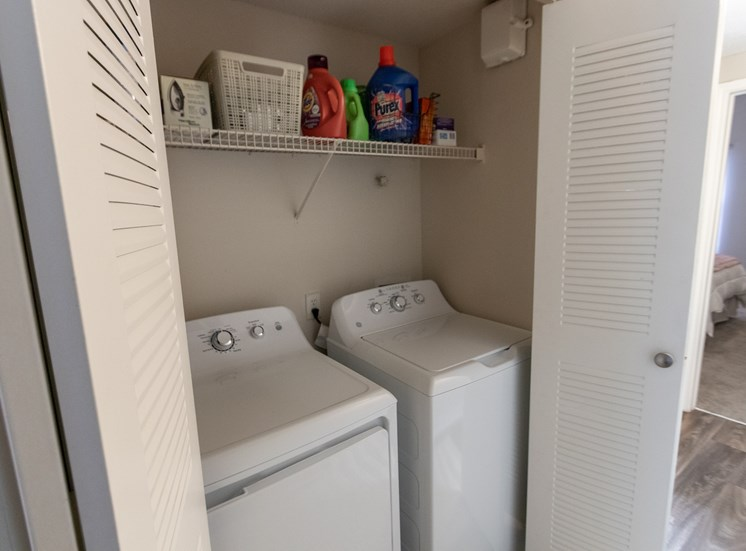 This is a photo of the utility closet with full-size washer and dryer in the 1135 square foot 2 bedroom Retreat floor plan at The Sanctuary at Fishers Apartments in Fishers, IN.