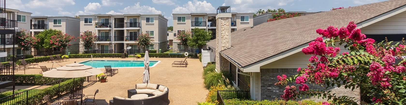 This is a photo of the pool area at The Summit at Midtown Apartments in Dallas, TX.