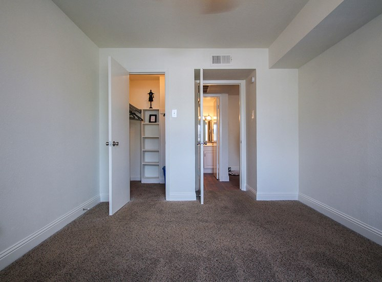 This is a photo of the bedroom in a 558 square foot 1 bedroom apartment at The Summit at Midtown Apartments in Dallas, TX.