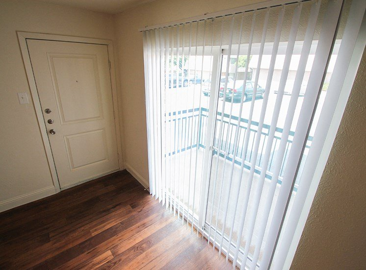 This is a photo of the patio doors in a 558 square foot 1 bedroom apartment at The Summit at Midtown Apartments in Dallas, TX.