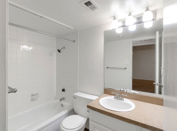 This is a photo of bathroom in the 751 square foot 1 bedroom apartment at Woodbridge Apartments in Dallas, TX.