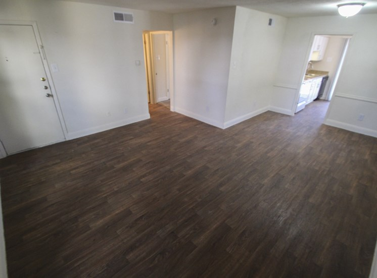 This is a photo of the living room of the 751 square foot 1 bedroom apartment at Woodbridge Apartments in Dallas, TX.