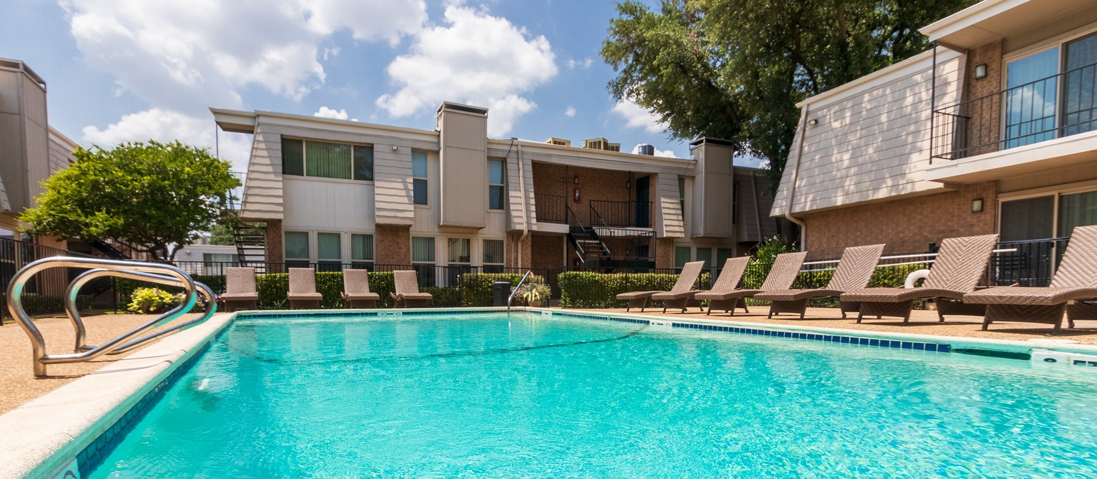 This is a photo of the pool area at Woodbridge Apartments in Dallas, Texas.