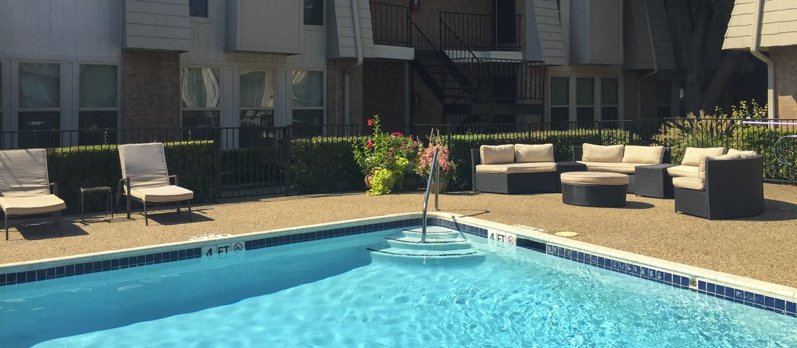 This is a photo of the swimming pool at Woodbridge Apartments in Dallas, TX.