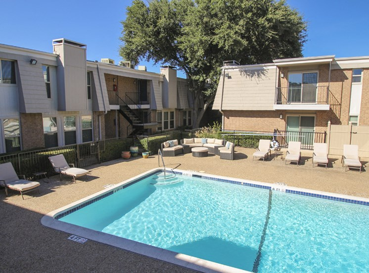 This is a photo of the pool area at Woodbridge Apartments in Dallas, TX