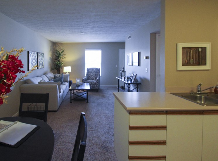 This is a photo of the living room from the dining area in the 890 square foot 2 bedroom Liberty at Washington Place Apartments in Centerville, OH.