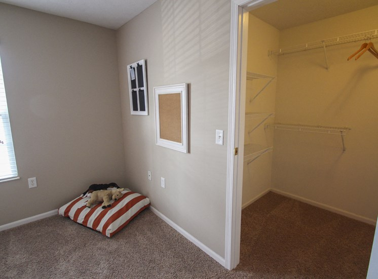 This is a photo of the walk-in closet in the second bedroom of the 890 square foot 2 bedroom Liberty at Washington Place Apartments in Centerville, OH.