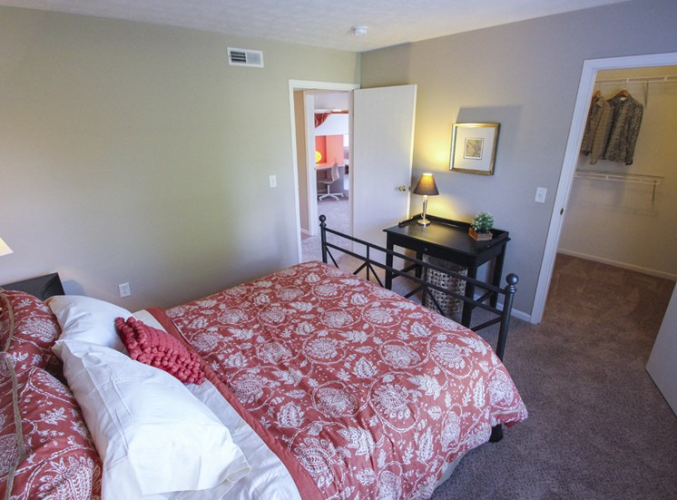 This is a photo of the master bedroom of the 890 square foot 2 bedroom Liberty at Washington Place Apartments in Centerville, OH.